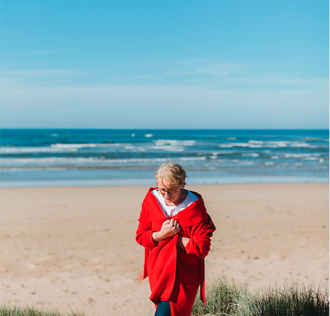 Thoughtful woman on the beach